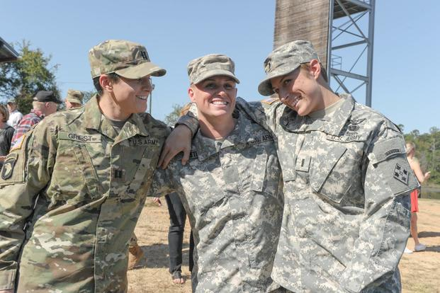 From left, U.S. Army Capt. Kristen Griest, Maj. Lisa Jaster and 1st Lt. Shaye Haver share a moment following Jaster's graduation from Ranger School on Fort Benning, Ga., Oct. 16, 2015. (U.S. Army/Staff Sgt. Alex Manne/ Released)