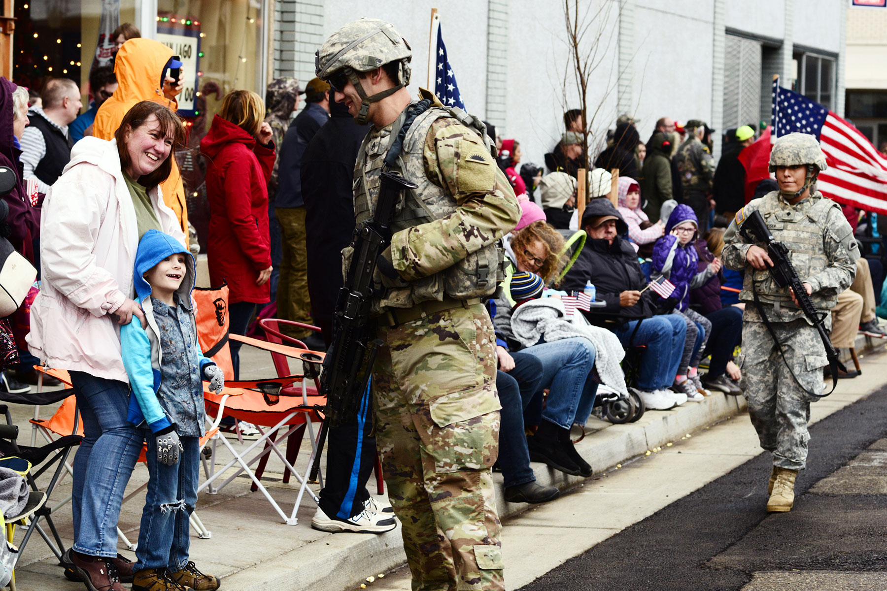 Oregon Army National Guard Soldiers with the 41st Infantry Brigade Combat Team greet spectators along the parade route during the annual Albany Veterans Day Parade, November 11, 2017, in Albany, Oregon.  (Oregon Military Department Public Affairs/April Davis)