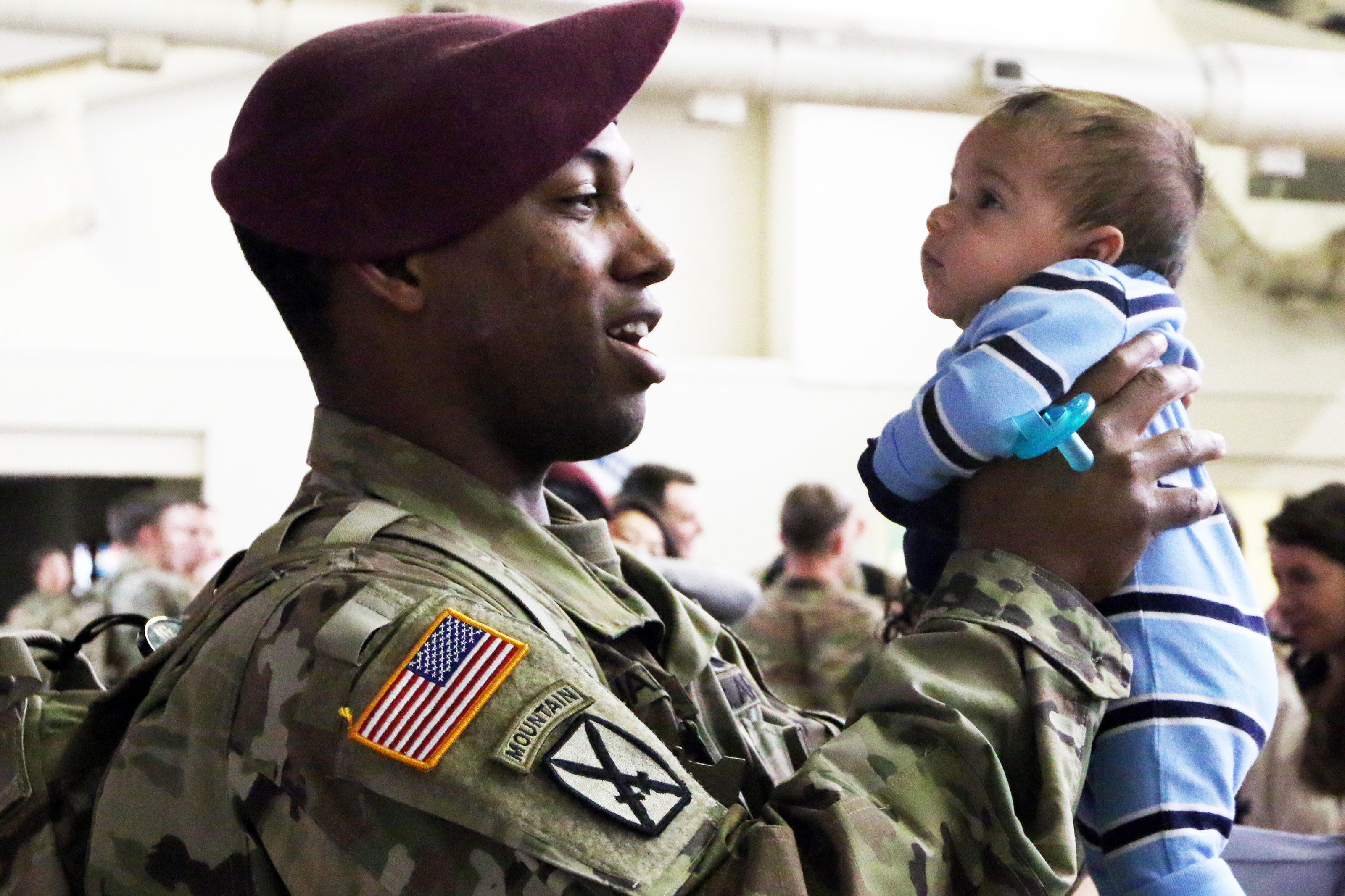 Families and friends reunite with Paratroopers from 1st Brigade Combat Team, 82nd Airborne Division, Mar. 19th at Pope Army Airfield on Fort Bragg, N.C. (U.S. Army/Sarah Goss)