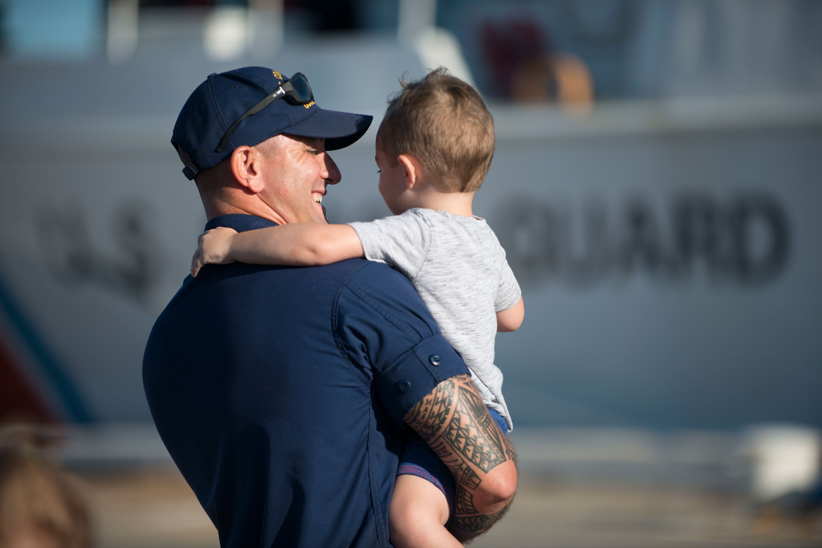 A Coast Guard Cutter Valiant crewmember hugs his child Friday, Sept. 29, 2017, at Naval Station Mayport, Florida. The Valiant crew returned to homeport after a 60-day multi-mission patrol in the Caribbean. (U.S. Coast Guard/Ryan Dickinson)