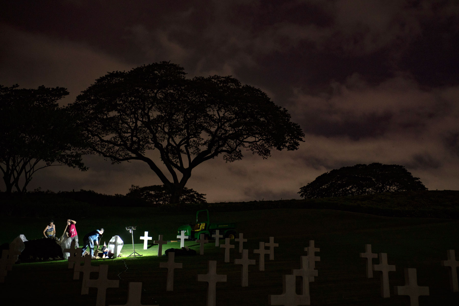 Local workers with the American Battle Monuments Commission (ABMC) uncover a casket at the Manila American Cemetery and Memorial in Manila, Philippines, June 6, 2018. ABMC worked with the Defense POW/MIA Accounting Agency (DPAA) to exhume the remains from 23 graves as part of DPAA's effort to identify personnel that died in the Cabanatuan POW camp during WWII. (U.S. Air Force photo by Tech. Sgt. Kathrine Dodd)
