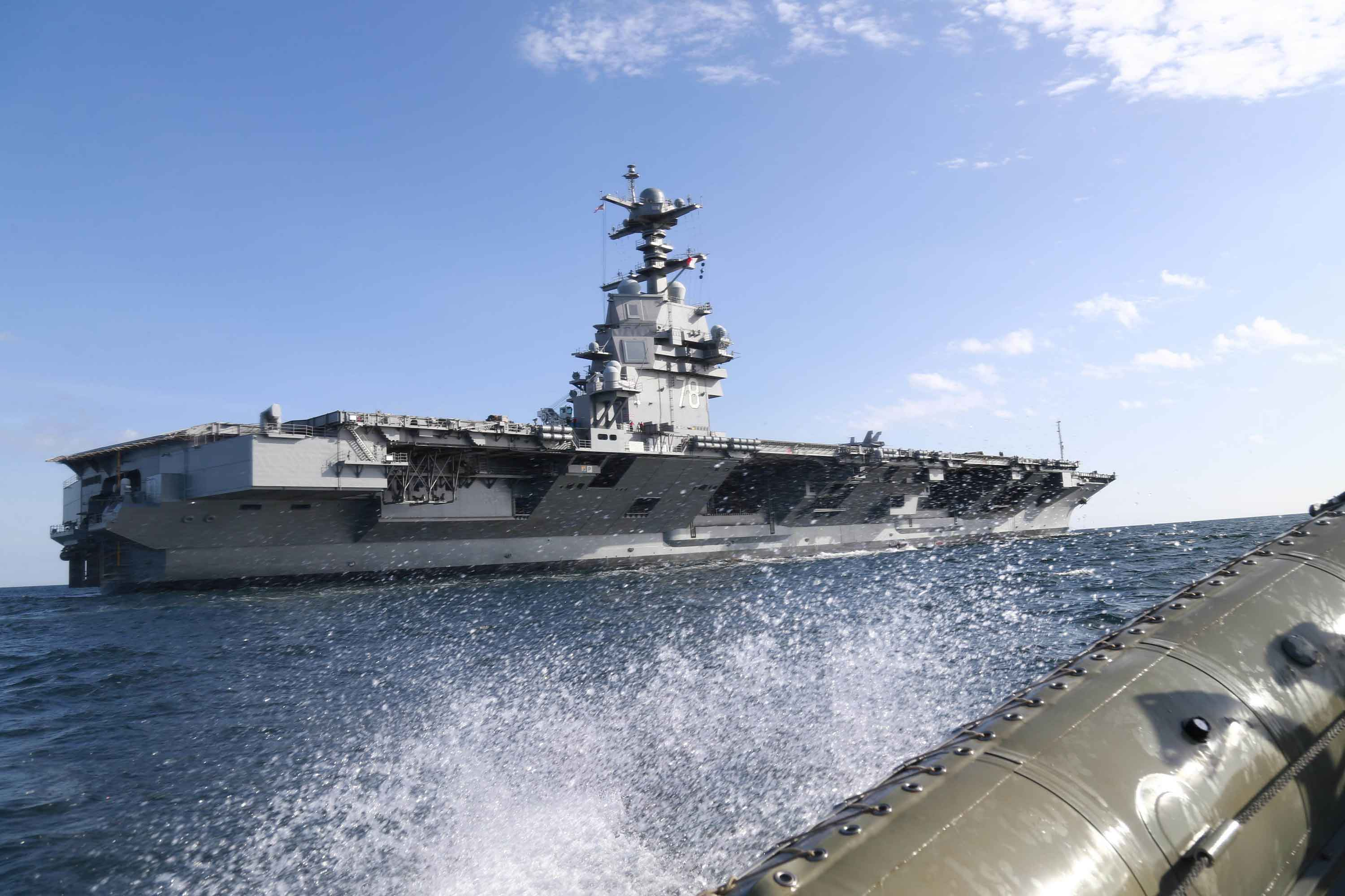Under Pressure, Navy's Top official Pledges to Solve New Carrier's Problems