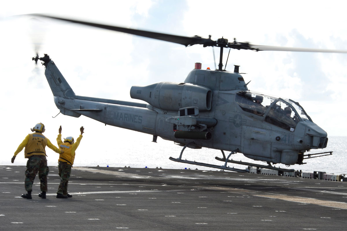 AH-1W Super Co | Military.com on uh-1n helicopter, uh-1h helicopter, agusta a129 mangusta, uh-1y venom, mh-60r helicopter, ch-53e super stallion, ah-1z helicopter, vh-3 helicopter, mh-60 helicopter, h-46 helicopter, hal light combat helicopter, uh-1b helicopter, ah-64 helicopter, ch-47 helicopter, ch-46 sea knight, ah-1 helicopter, uh-1y helicopter, f-14 tomcat, ah-1z viper, f/a-18 hornet, v-22 osprey, uh-1 iroquois, ah-1 cobra, ch-47 chinook, ah-64 apache, ch-53 sea stallion, attack helicopter, uh-1 helicopter, sh-60f helicopter, f-15 eagle, mh-53 helicopter, oh-58 kiowa, ch-46 helicopter, c-130 helicopter, f-16 fighting falcon, mh-60s helicopter, md helicopters mh-6 little bird, uav helicopter, mh-53e helicopter,
