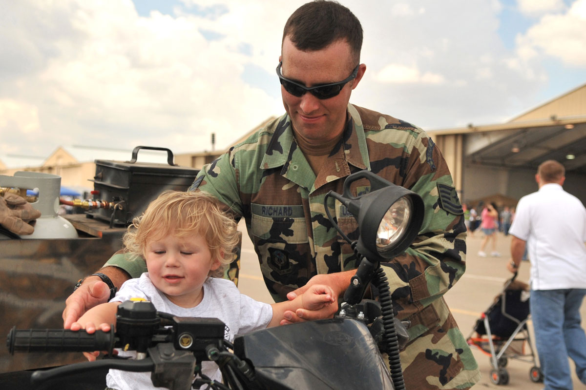 Special Operations Airman Sits on ATV with Son