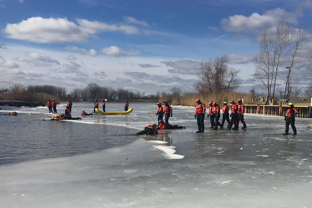 Coast Guard members complete training during the last day of the final 2017 Ice Rescue Training Course at the National Ice Rescue School in Essexville, Mich., Feb. 16, 2017. (U.S. Coast Guard photo)