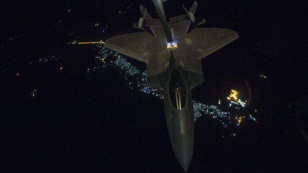 A KC-10 Extender from the 908th Expeditionary Air Refueling Squadron, Al Dhafra Air Base, United Arab Emirates, refuels an F-22 Raptor from the 95th Expeditionary Fighter Squadron in support of a new offensive campaign in Afghanistan Nov. 19, 2017. (U.S. Air Force Photo by Gregory Brook)