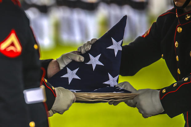 Marine Corps Body Bearers with Bravo Company, Marine Barracks Washington D.C., fold the National Flag during a full honors funeral at Arlington National Cemetery, Va., Sept. 13, 2017. (U.S. Marine Corps photo/Lance Cpl. Damon Mclean)