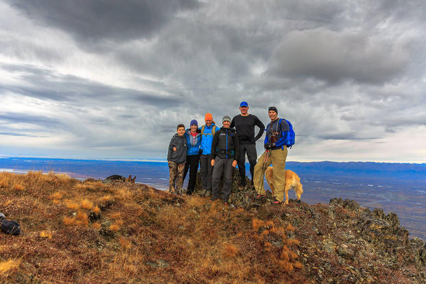 A group of hikers, including three Gold Star family members, stands on top of the mountain Kirk Alkire, second from right, hopes will soon be named Gold Star. (Photo courtesy of Kirk Alkire)