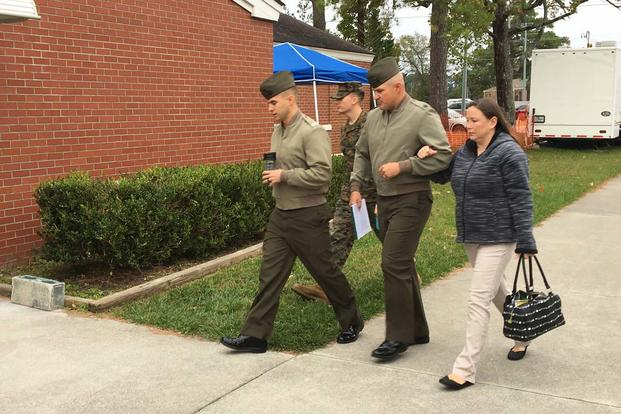 Gunnery Sgt. Joseph Felix enters a military courthouse Nov. 8, 2017, at Camp Lejeune, N.C. (Hope Hodge Seck/Military.com)
