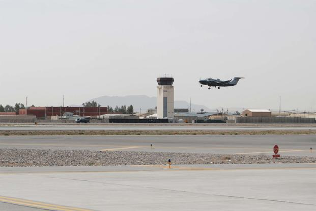 FILE -- An MC-12W Liberty departs Kandahar Airfield, March 20, 2014. (U.S. Air Force/Capt. Brian Wagner)