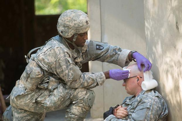 U.S. Army Expert Field Medical Badge (EFMB) candidate provides care to a casualty during EFMB testing at Fort Bragg, NC, October 20, 2017. (Spc. Shekinah M Frye/U.S. Army)