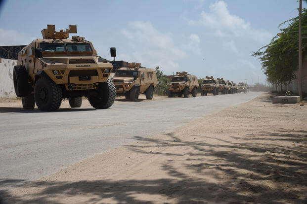 A convoy of armored troop provided by the U.S. Department of Defense and Department of State drive to the Uganda People's Defence Force compound, Mogadishu International Airport, Somalia, Sept. 25, 2017. (U.S. Air National Guard photo/Andria Allmond)