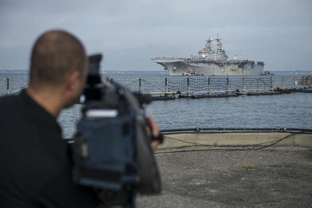 The amphibious assault ship USS Kearsarge (LHD 3) arrives at Naval Station Norfolk following Hurricane Maria relief efforts, Nov. 6, 2017. (U.S. Navy photo/Mass Communication Specialist 2nd Class Justin Wolpert)