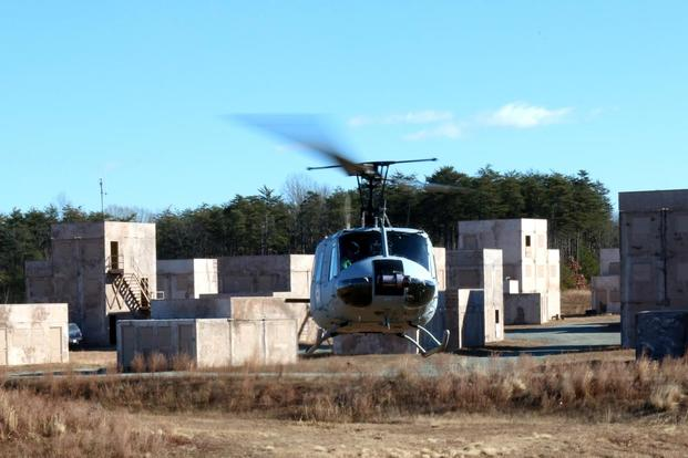 The Marine Corps demonstrated a new type of drone helicopter called the Autonomous Aerial Cargo/Utility System, or AACUS, on Dec. 13, 2017, at Quantico, Va. A backup pilot can be seen in the cockpit. (Military.com photo by Matthew Cox)