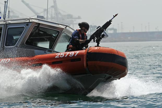 FILE -- Boat crewmen with Maritime Safety and Security Team Los Angeles – Long Beach conduct tactical boat maneuvers during an exercise, July 31, 2012. (U.S. Coast Guard/Petty Officer 1st Class Adam Eggers)