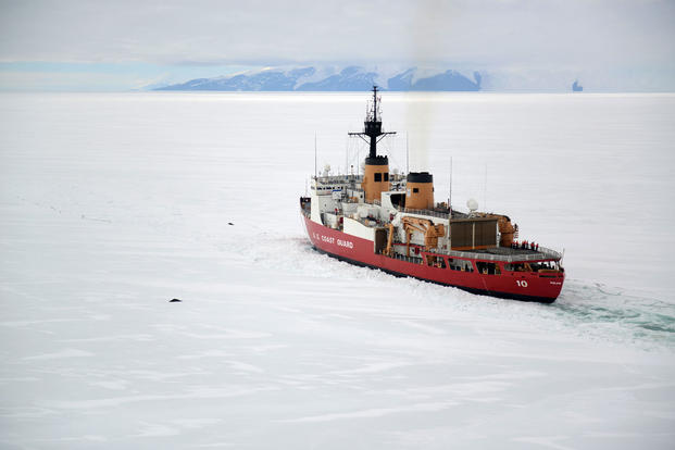 The crew of the Coast Guard Cutter Polar Star operates near two seals off the shore of Antarctica, Jan. 16, 2017. (U.S. Coast Guard photo/David Mosley)