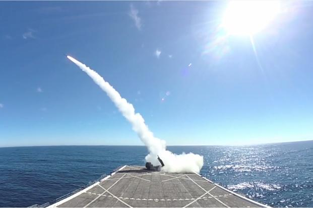 U.S. Marines launch a rocket from a High Mobility Artillery Rocket System (HIMARS) off the USS Anchorage (LPD-23) during Exercise Dawn Blitz, Oct. 22, 2017. (Photo via video by Lockheed Martin via U.S. Defense Department)