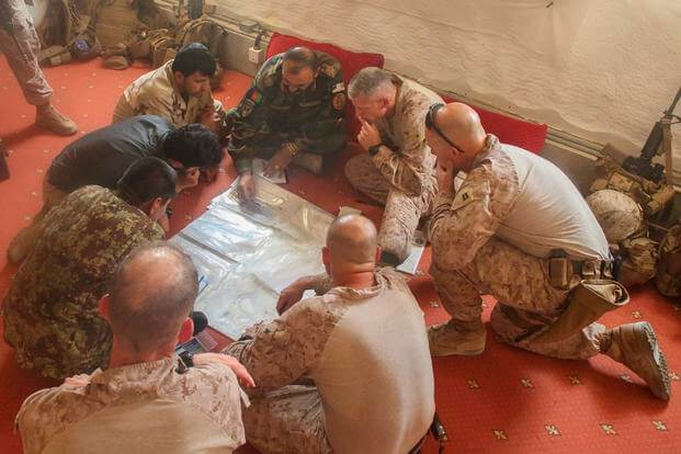 U.S. Marines with Task Force Southwest and Afghan National Army soldiers with the 215th Corps plan for the continuation of offensive combat operations at Camp Hanson, Afghanistan, June 13, 2017. (U.S. Marine Corps photo)