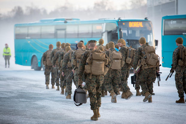 U.S. Marines with Black Sea Rotational Force 17.1 prepare to board a bus after arriving in Vaernes, Norway, Jan. 16, 2017. (U.S. Marine Corps photo/Sgt. Erik Estrada)