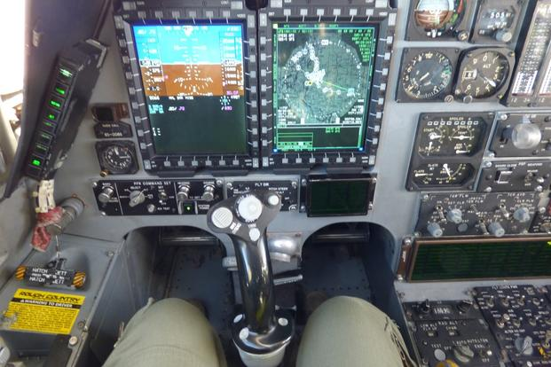 "The cockpit display while sitting left seat. The ""088"" tail was recently upgraded with a central integrated test system, fully integrated data link and vertical situation display upgrade. (Military.com photo/Oriana Pawlyk)"