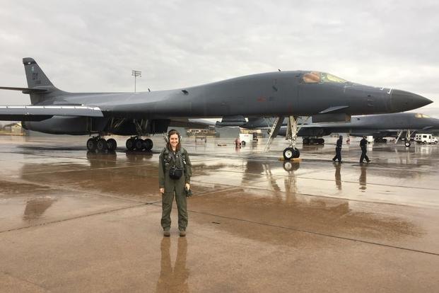 "Military.com reporter Oriana Pawlyk stands in front of a B-1 bomber, tail ""088,"" Dec. 19, 2017, at Dyess Air Force Base, Texas. (Photo by 7th Bomb Wing/Dyess Public Affairs)"