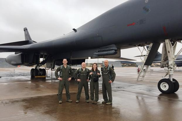 "Military.com reporter Oriana Pawlyk with B-1 crew from left: 9th Bomb Squadron commander and weapons system officer Lt. Col. Erick Lord; Maj. Charles Kilchrist, B-1 pilot; and Capt. ""Goa"" Trafton. (Photo by 7th Bomb Wing/Dyess Public Affairs)"