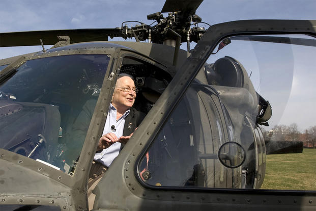 Retired Col. Sally Murphy checks out a Black Hawk helicopter at Fort Myer during a Freedom Team Salute program honoring her as the first woman to complete Army flight school at Fort Rucker in 1974 and became the Army's first female helicopter pilot. (U.S. Army)