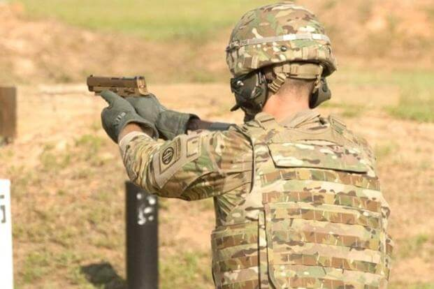 A service member fires the Sig Sauer P320 during Modular Handgun System tests for the U.S. Army Operational Test Command, conducted at Fort Bragg, N.C. Aug. 27. (Photo Credit: U.S. Army photo by Lewis Perkins)