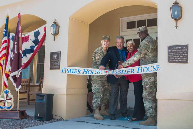 Col. John A. Smyrski III, commander, William Beaumont Army Medical Center, John Ost III, di-rector, Army Fisher House Program, Alice Coleman, manager, WBAMC Fisher House, and Command Sgt. Maj. Donald George, command sergeant major, WBAMC, cut the ribbon to the newly renovated Fisher House on the WBAMC campus, May 12, 2017. (William Beaumont Army Medical Center Public Affairs Office/Marcy Sanchez)