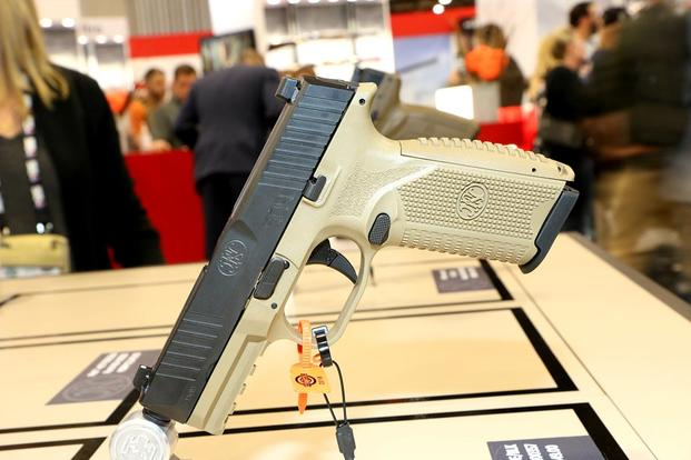 Gun Makers Gamble in Vegas on Commercial Versions of Army