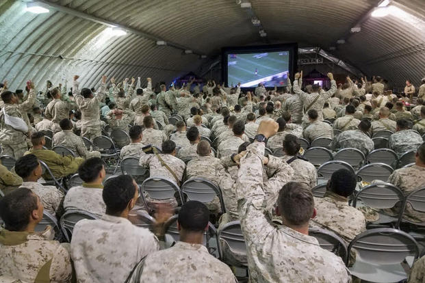Marines and sailors cheer during Super Bowl LI in the dining facility at Camp Wilson on board Marine Corps Air Ground Combat Center, Twentynine Palms, Calif., Feb. 5, 2017. (US Marine Corps photo/Levi Schultz)