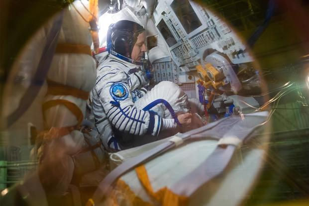 In the Integration Building at the Baikonur Cosmodrome in Kazakhstan, crewmember Jack Fischer of NASA sits in the Soyuz MS-04 spacecraft April 6 as part of pre-launch preparations. (NASA/Gagarin Cosmonaut Training Center/Andrey Shelepin)