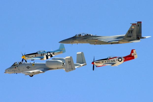 Two P-51 Mustangs, an A-10 Thunderbolt II and an F-15D Eagle team up during an air show at Nellis Air Force Base, Nov. 13 and 14. (U.S. Air Force/Julie Ray)