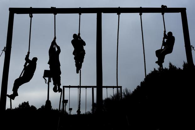 FILE PHOTO -- U.S. Marine candidates with Officer Candidates school (OCS) participate in an obstacle course at OCS, Marine Corps Base Quantico, Va., on Jan. 16, 2018. (U.S. Marine Corps/Lance Cpl. Yasmin D. Perez)