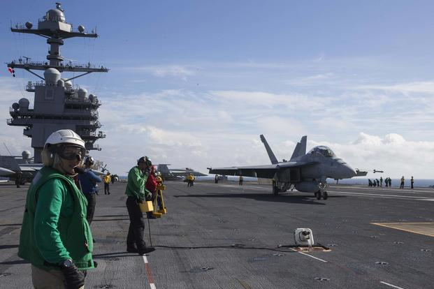"An F/A-18F Super Hornet, assigned to the ""Swordsmen"" of Strike Fighter Squadron (VFA) 32, approaches the USS Gerald R. Ford's (CVN 78) Electromagnetic Aircraft Launching System (EMALS) during flight deck operations in the Atlantic Ocean on Nov. 6, 2017. (U.S. Navy photo by Mass Communication Specialist 2nd Class Kristopher Ruiz)"