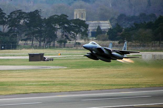 FILE -- An F-15C Eagle from the 493rd Fighter Squadron takes off from Royal Air Force Lakenheath, England, March 6, 2014. (U.S. Air Force/Staff Sgt. Emerson Nunez/Released)