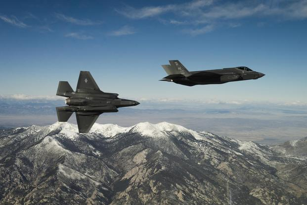 Two U.S. Air Force F-35A Lightning IIs, assigned to the 4th Fighter Squadron from Hill Air Force Base, Utah, conduct flight training operations over the Utah Test and Training Range on Feb 14, 2018. (U.S. Air Force/Staff Sgt. Andrew Lee)