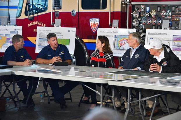 President Trump, and Texas Gov. Greg Abbott are briefed by Coast Guard Atlantic Area Commander Vice Admiral Karl Schultz (second from the left) during a Hurricane Harvey response update at Fire Station 5 in Corpus Christi, Texas, Aug. 29, 2017. (Coast Guard/Petty Officer 1st Class Patrick Kelley)