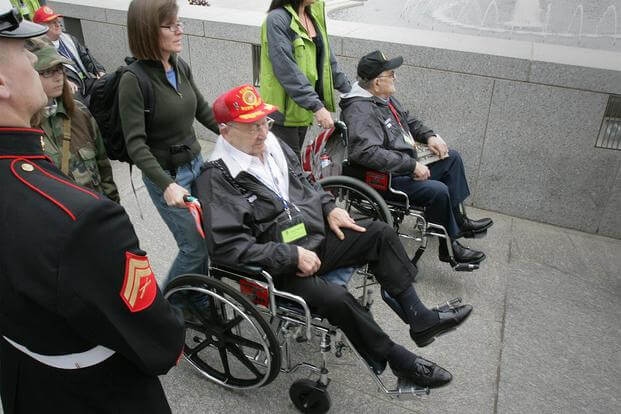 World War II veterans arrive at the World War II Memorial in Washington, D.C., for a ceremony honoring their service in the Pacific theater March 11, 2010. (U.S. Marine Corps/Cpl. Scott Schmidt)