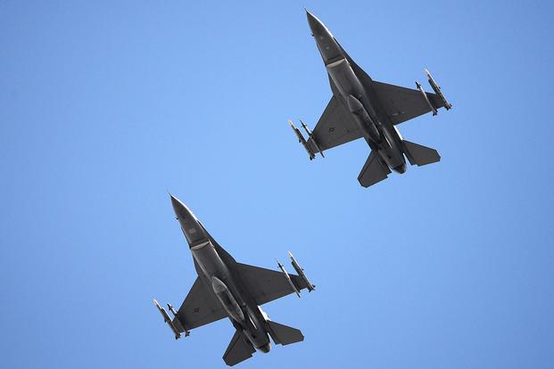 U.S. Air Force F-16C Fighting Falcons fly over the Air Dominance Center in Savannah, Georgia, March 12, 2018. (U.S. Air National Guard/Senior Airman Cristina J. Allen)