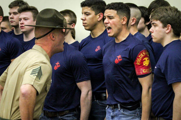 A Marine Corps drill instructor shouts commands to an enlistee during Drill Instructor Family Night in West Des Moines, Iowa on March 23. The Corps plans to grow by 1,100 Marines in fiscal 2019. (US Marine Corps photo/Levi Schultz)