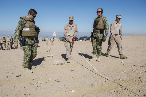 Marines and Coast Guardsmen participating in Exercise Eager Lion 2017 prepare a firing line for weapons training with Jordanian and Italian forces. (U.S. Navy Combat Camera photo/Mass Communication Specialist 2nd Class Austin L. Simmons)