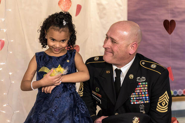 Cayleigh Hinton and Illinois National Guard 1st Sgt. Joseph Bierbrod arrive at a father-daughter dance in February. Cayleigh's father, Sgt. Terrence Hinton, died in a 2017 training accident. (Illinois National Guard/Staff Sgt. Robert R. Adams)