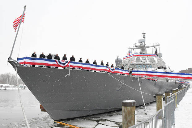 The Blue crew of the freedom variant littoral combat ship USS Little Rock (LCS 9) man the rails during the ship's commissioning ceremony Dec. 16, 2017 in Buffalo, N.Y. (U.S. Navy photo courtesy of Lockheed Martin)