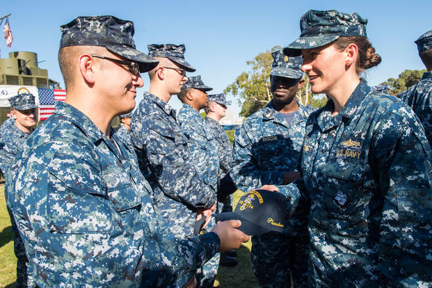 Cmdr. Emily Bassett, commanding officer, littoral combat ship (LCS) crew 214, give the opening remarks during the LCS crew 214 commissioning ceremony, Nov. 10, 2016. (U.S. Navy photo/Christopher A. Veloicaza)