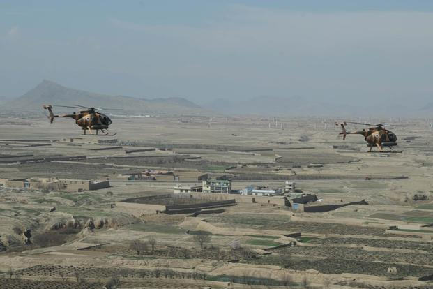 "The MD-530 Warrior, or ""Jengi"" in Dari provides air power to support the ANDSF. The ""Jengi"" is designed for high altitude and hot weather operations. (U.S. Air Force/Capt. Jeffre Nagan)"