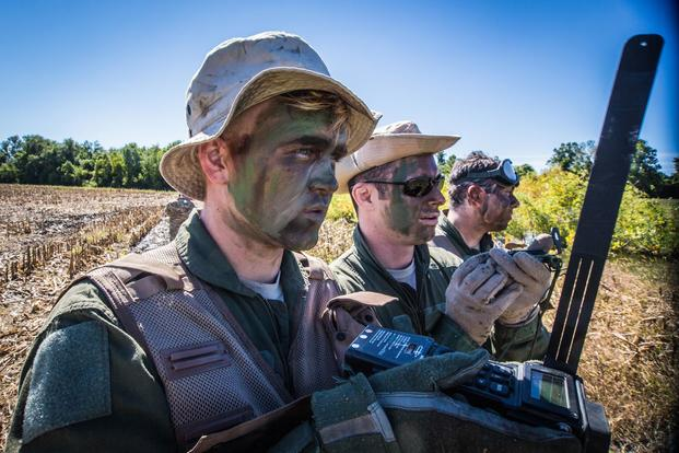 U.S. Air Force Senior Airman Cody Harter (left) assigned to the 180th Airlift Squadron, Missouri Air National Guard, radios for a helicopter extraction, during Survival Evasion Resistance and Escape (SERE) training at Rosecrans Air National Guard Base, St. Joseph, Mo., Sept. 29, 2016. (U.S. Air Force/Senior Airman Patrick P. Evenson)