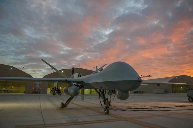 An MQ-9 Reaper equipped with an extended range modification from the 62nd Expeditionary Reconnaissance Squadron sits on the ramp at Kandahar Airfield, Afghanistan, Dec. 6, 2015. (U.S. Air Force/Tech. Sgt. Robert Cloys)