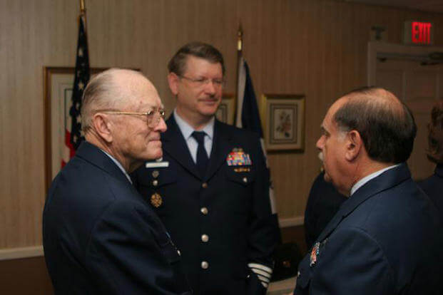 Robert Birrane, left, at a Change of Watch meeting at Baltimore restaurant with Barry Cohan and Bruce Johnson, Feb. 17, 2013. (U.S. Coast Guard photo/Joe Conn)
