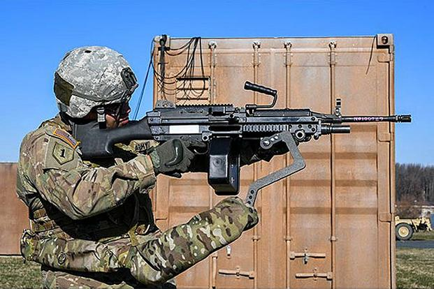 Army Sgt. Michael Zamora uses a prototype Third Arm exoskeleton to easily aim an 18-pound M249 light machine gun during testing at Aberdeen Proving Ground, Maryland, on March 14, 2018. (U.S. Army photo by Conrad Johnson)